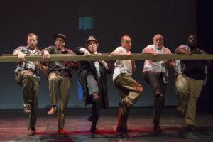 Men singing onstage