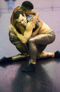 Timothy June and Manuel Valdes embrace